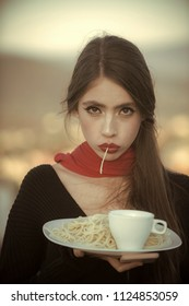restaurant menu. Woman eating pasta as taster or restaurant critic. woman with italian pasta and tea or coffee.