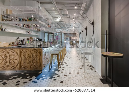 Restaurant In A Modern Style With Gray Walls And Black White Tiles On The Floor