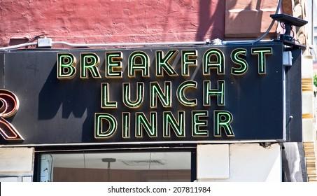 Restaurant neon sign breakfast lunch dinner in New York USA