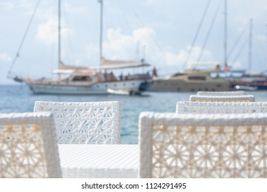 Restaurant on the sea with a view of the yacht. The concept of enjoying solitude and tranquility.