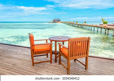 Restaurant on a wooden pier against the azure water of the ocean