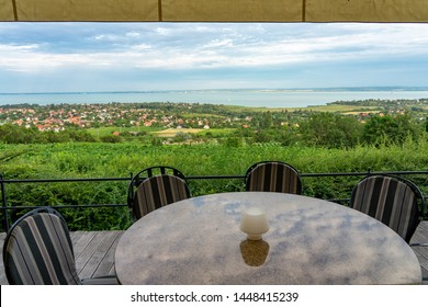 Restaurant over the Lake Balaton on the hill Dinner, lunch, romantic date, eating on nature. Csopak wine restaurant table with view