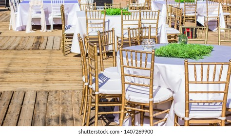 restaurant patio empty ambiance with wooden table and chairs furniture ready for some wedding or birthday event, exterior decoration concept photography