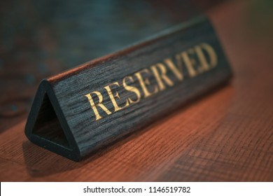 restaurant reservation sign on the table. Order dinner dinner and breakfast in the cafe. Stock Photo