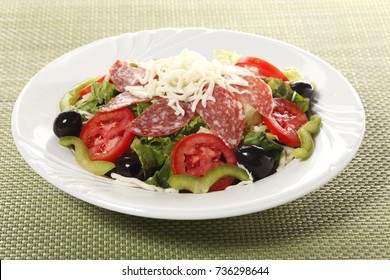 Restaurant salad with salami