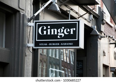 """Restaurant signs on the streets of Amsterdam. """"Ginger"""" restaurant sign. The restaurant in the center of Amsterdam. The place that tourists prefer. Amsterdam. Netherlands. December 2017."""