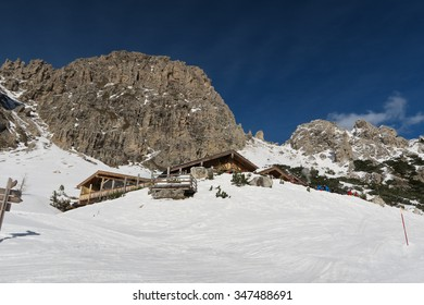 Restaurant in the ski resort Canazei with Italian Dolomites in the background.