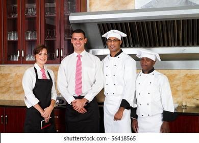restaurant staff inside industrial kitchen