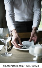 Restaurant Staff Setting Table in Restaurant for Reception