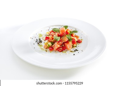 Restaurant Starter Menu with Raw Salted Salmon Slices, Tomato and Cucumber Isolated on White Background. Diced Red Fish or Trout with Vegetables, Herbs and Spices on Elegant Flat Plate Close Up