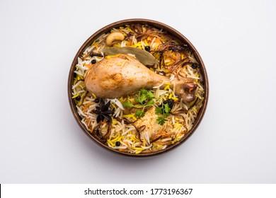 Restaurant style Spicy Chicken Biryani in wooden bowl with Raita and salan, Popular Indian or Pakistani Food - Shutterstock ID 1773196367