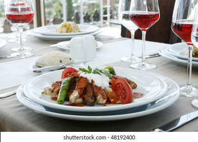 restaurant table with meat and red wine