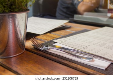 Restaurant table outdoors with menu and cutlery/Restaurant background/Dining out in London