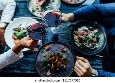Restaurant table set main dish steak fish cuisine fine dinning white wine glass cooler candle light wooden table atmosphere menu.