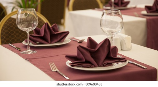 Restaurant table setting with wine glass