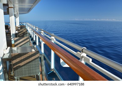 Restaurant tables on the open deck of cruise ship. Caribbean sea view