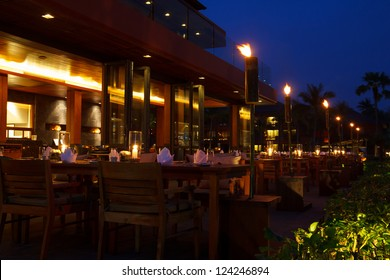 Restaurant tables outdoor table setting at evening