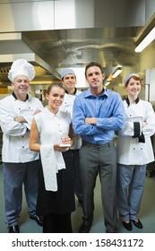 Restaurant team posing together in a kitchen