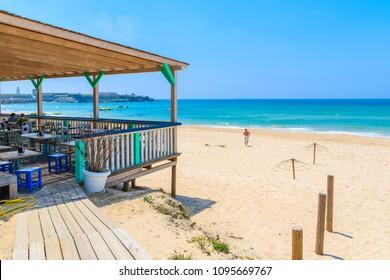 Restaurant terrace on sandy Tarifa beach, Costa de la Luz, Spain
