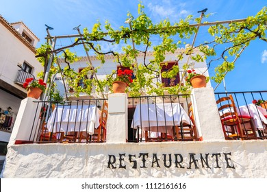 Restaurant terrace in picturesque white village of Mijas, Andalusia, Spain