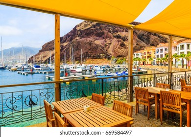 Restaurant terrace in sailing port on coast of Madeira island, Portugal