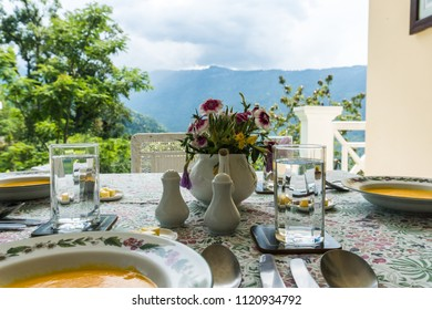 Restaurant Terrace Table with Plates with Mountains in Background