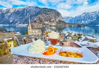 The restaurant with top view on Halltatt, Hallstattersee lake and Alps offers tasty apple strudel with whipped cream, orange and Wiener melange coffee drink, Salzkammergut, Austria
