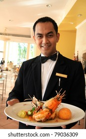 restaurant waiter holding food
