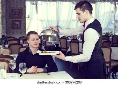 restaurant waiter to serve clients