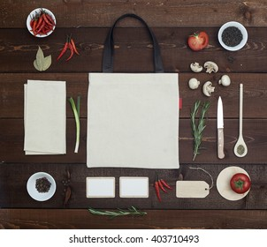 Restaurant wooden table with bag, business card and another utensil, top view
