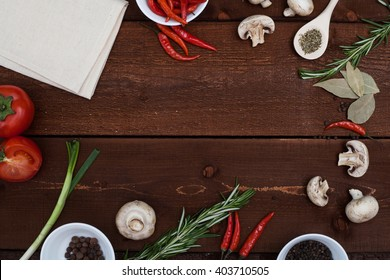 Restaurant wooden table with ingredients and utensil, top view frame