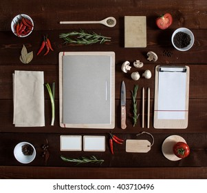 Restaurant wooden table with menu and utensil, top view