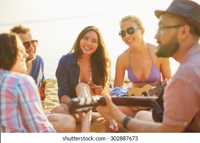 Restful friends spending vacations on sandy beach