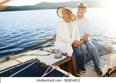 Restful senior couple having voyage on yacht