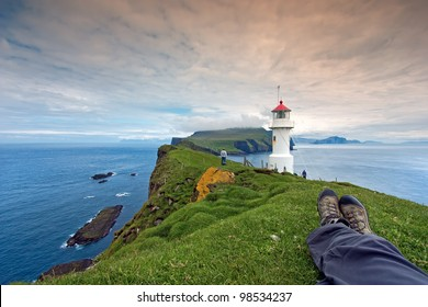 Resting after hiking at Mykines Lighthouse, Faroe Islands