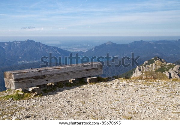 "Resting bench in the bavarian alps, Germany, with view to lake ""Walchensee"""