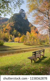 resting bench in oberammergau landscape, with view to kofel mountain, upper bavaria