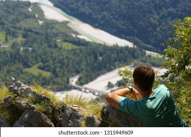 Resting man watchig a valley of Soca river, Slovenia