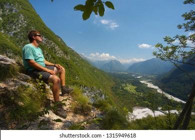 Resting man watching a valley of Soca river, Triglav NAtional Park, Slovenia