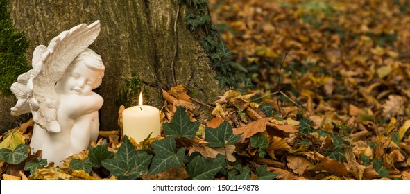 Resting place in nature, cherub with burning candle