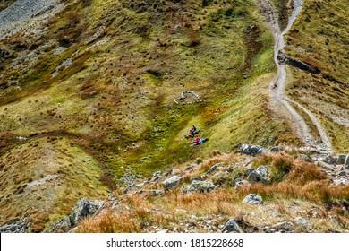Resting tourists and stoned heart Western Tatras mountains, Slovak republic. Hiking theme. Seasonal natural scene.