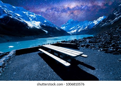 Resting wooden table and chair with wilkyway background at Mount Cook, New Zealand