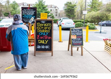 Reston, USA - April 1, 2020: Trader Joe's grocery store sign for senior disabled customers special hours, customer limit and grocery bagging paper bag restriction at covid-19 coronavirus outbreak
