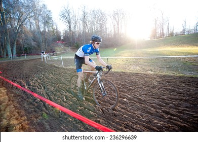 RESTON, VIRGINIA - DECEMBER 7: A cyclist braves the mud in the elite men's event of the Capital 'Cross Classic cyclocross competition on December 7, 2014 in Reston, Virginia