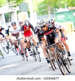 RESTON, VIRGINIA - JUNE 23: Cyclists compete in the Reston Town Center Grand Prix on June 23, 2013 in Reston, Virginia