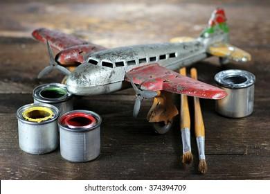 restoration of an antique tin toy plane
