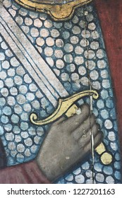 Restoration: close up of a painting final retouch