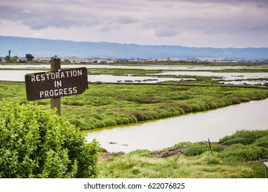 Restoration sign in the wetlands in Alviso Marsh, Don Edwards wildlife refuge, south San Francisco bay, California