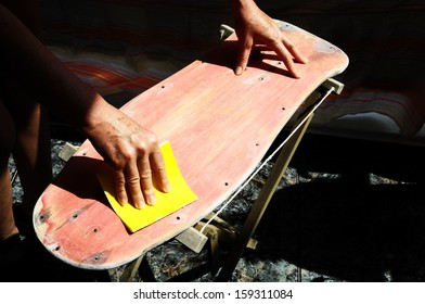 Restore an Old Skateboard with a Yellow Sandpaper