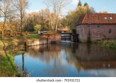 The restored historic water mill called Berenschot in the stream of the river the Boven-Slinge in Winterswijk in Hamlet the Achterhoek in the Netherlands.